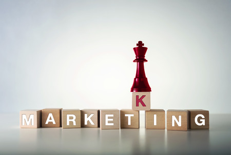 Market king concept with wooden blocks and chess Stock Photo