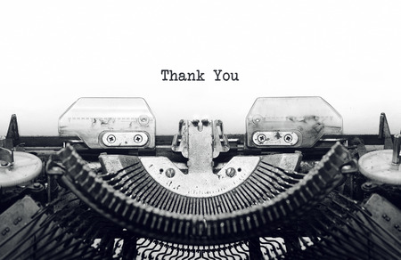 Vintage typewriter on white background with text thank you. Banque d'images