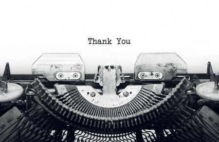 Vintage typewriter on white background with text thank you. Stock Photo