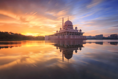 Putra Mosque motion sky sunrise moments. The Mosque is the principal mosque of Putrajaya, Landmark in Malaysia / Shallow depth of field, slight motion blur.