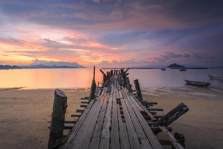 Beautiful sunset Jetty at Black Sand Beach Village in Langkawi Island, Malaysia.