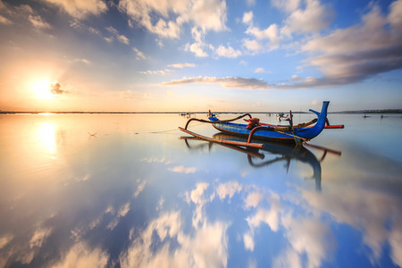 morning sun in Bali, Indonesia. Traditional fishing boats at Sanur beach, Bali, Indonesia.