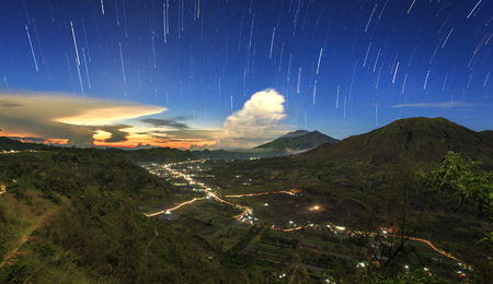 Night photography. Amazing star trail over Pinggan Hill, Bali, indonesia. Stock Photo