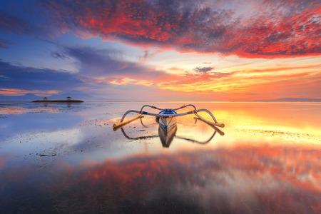 Balinese jukung fishermen with beautiful sunrise in Bali, Indonesia