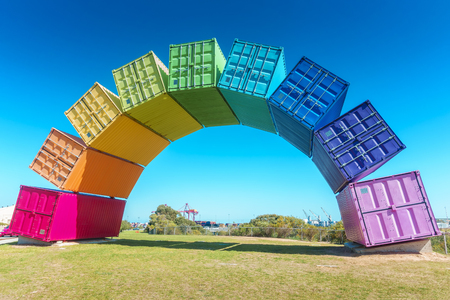 A rainbow of sea containers against a beautiful blue sky in Fremantle, Western Australia.