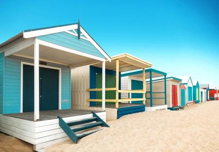 Beautiful Bathing houses at sandy beach at Brighton beach in Melbourne, Australia.