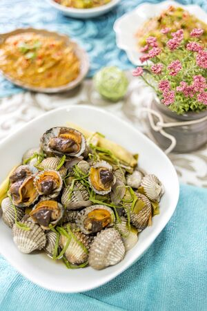 Kerang rebus or sea shell steam, deliciously enjoy with spicy sauce.