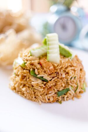 A plate of delicious home cooked fried rice which is popular in Malaysia, Indonesia, Thailand and Singapore 免版税图像 - 132928319