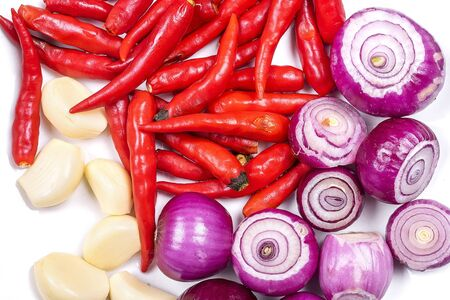Shallots (Red Onion), chilli and Garlics are popular ingredients in cooking on the white background isolated