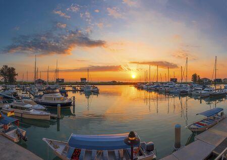 Boats and marina with beautiful sunset