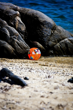 A beachball next to the rock on a summer holiday in Sarti, Greece  photo