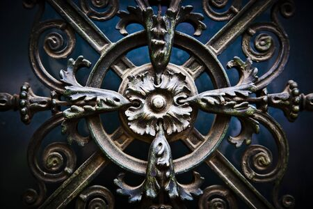 Beautiful, decorative antique flowers made of metal on a big cahtedral s door photo