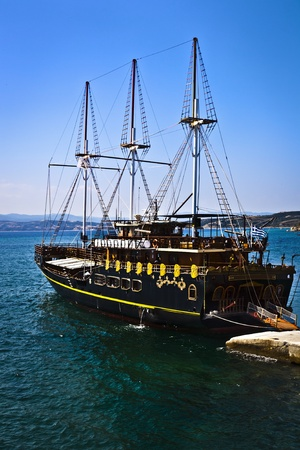galley: Vintage wooden ship sailing on the blue sea with blue sky