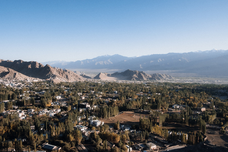 Landscape and building in Leh Ladakh city with mountains and blue sky background Stock Photo