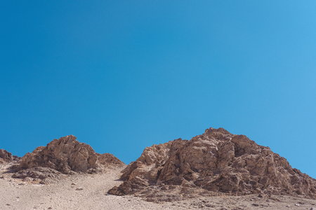 Closeup image of mountains and blue sky background in Ladakh , India