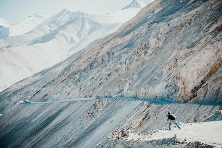 A photographer taking photos of Himalayas range in Ladakh , India Stock Photo