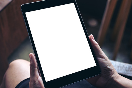 Mockup image of hands holding black tablet pc with blank white desktop screen Banco de Imagens - 109459482