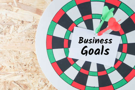 operational: word business goals on note paper dart  wood wall background