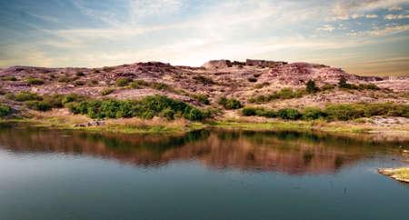 Rock mountain in front of dead lake