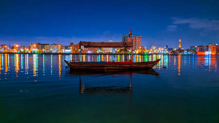 Wooden boat floating in old side of Dubai during night