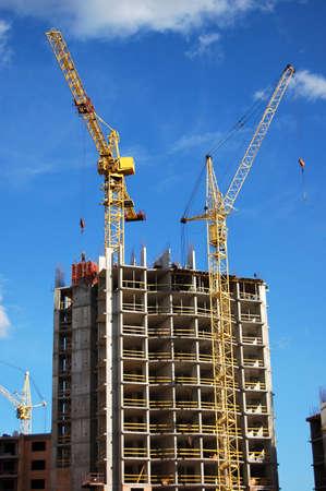 Cranes and building construction Foto de archivo