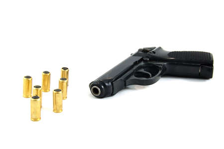 Pistol and bullets on isolated photo
