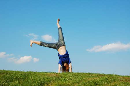 Cartwheel on meadow on a background blue sky Foto de archivo