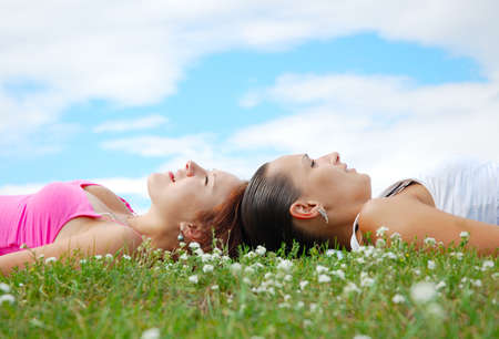 Girls resting on the meadow