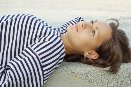 striped vest: Girl resting in the striped vest