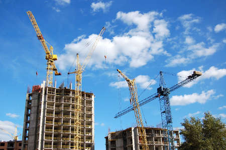 housebuilding: Tower cranes and house-building Stock Photo