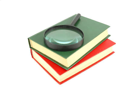 Two books and magnifying glass photo