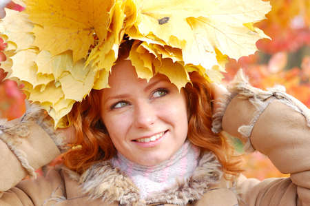 Portrait of beautiful girl in wreath of leaves photo