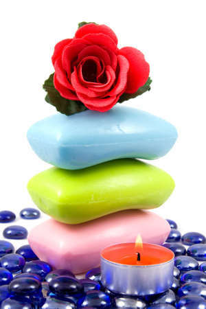 Colourful soap bars and aroma rose  on a white background photo