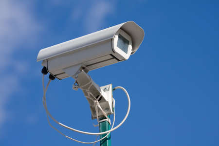 electronic survey: security video camera on background blue sky