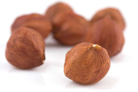 hazelnuts isolated on a white Stock Photo - 4580332
