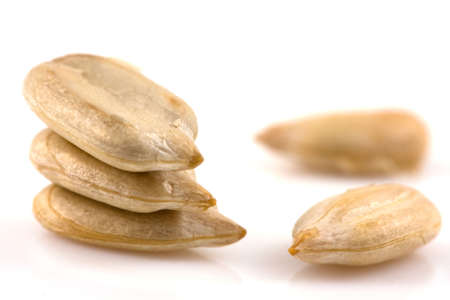 a seed: Sunflower seeds isolated on white