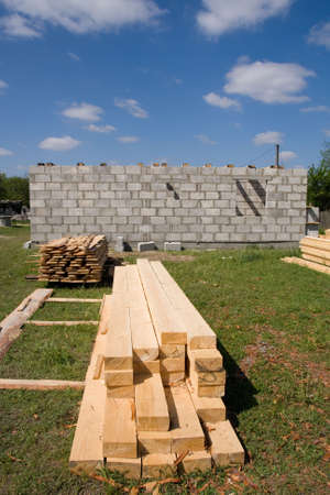 erect: house under construction on a background blue sky