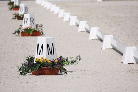 Horse Dressage Rings letter post and field fence Foto de archivo