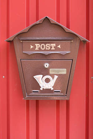 mailbox on the red door . photo
