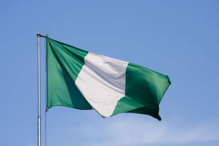 Flag of Nigeria on a background blue sky