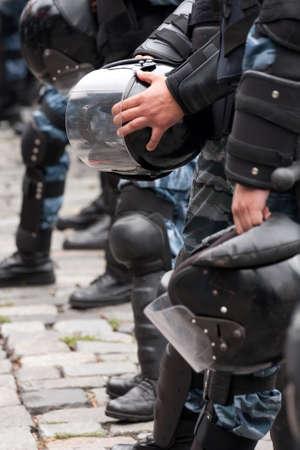 Helmet  on a police officer in the street  Foto de archivo