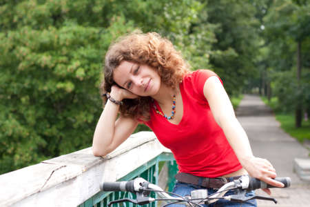 beautiful girl with a bicycle photo