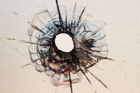 bullet hole in window - background  Foto de archivo