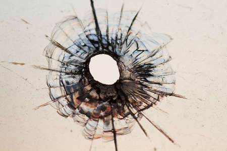 bullet hole: bullet hole in window - background  Stock Photo
