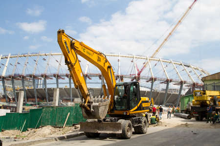 19: KYIV, UKRAINE - MAY 19 , 2011: The construction works of Kyivs Olympic stadium to championship opening on football UEFA EURO 2012 . May 19, 2011, Kiev, Ukraine