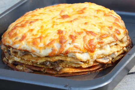 rubicund: Pancakes pie with  mushrooms, cheese and meat .