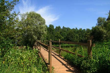 Wooden Bridge over River in Burgundy , France . Stock Photo - 11367390