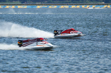 number 12: VYSHGOROD, UKRAINE - JULY 29 :Powerboat number 12 Qatar Team F1 fast speed , pilot Alex Carella .Grand Prix Formula 1 H2O World Championship Powerboat on July 29, 2011 in Vyshgorod, Ukraine