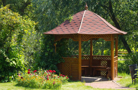 pergola: Beautiful wooden summerhouse and flowers