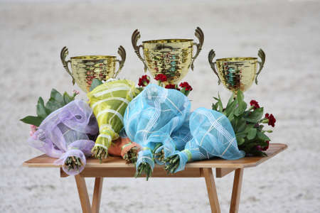 Gold trophy cups  and flowers photo